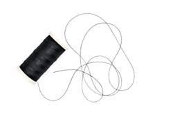 Spool of sewing thread on white background.