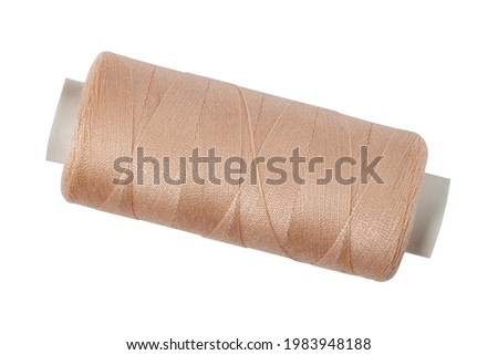 Spool of sewing thread on white isolated closeup. Foto stock ©