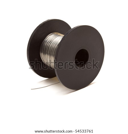 Spool of silver coloured resistance Wire on black plastic reel isolated against white. - stock photo