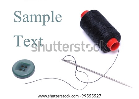 Spool of thread and needle isolated on white
