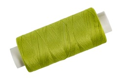 Spool of thread light green on white isolated, home creativity or needlework.