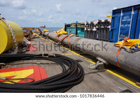 Spool pipe, lifting gears, anchor buoy and diving system on the work boat main deck  for gas pipeline installation at Sarawak Water, Malaysia. #1017836446