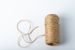 Spool rope on white background. Isolated. Embroidery thread yarn isolated, wool knitting. A set of isolated coils of coarse hemp rope.
