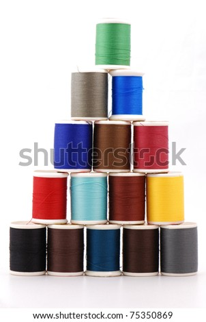 Spools of colours threads isolated on white