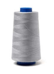 spools of thread for the textile industry on white background