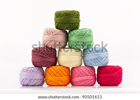 Spools of thread in various colors on white background