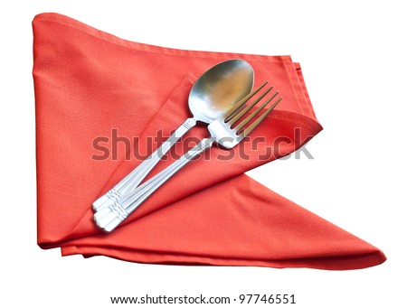 spoon and fork wrapped in red napkin isolated on a white background. - stock photo