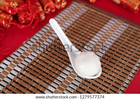 Spoon and spoon in a spoon on a bamboo mat #1279577374