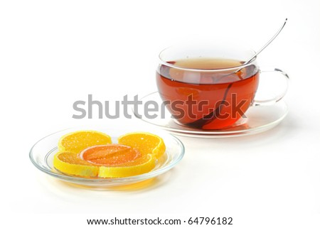 Spoon, cup of tea, sugar - stock photo