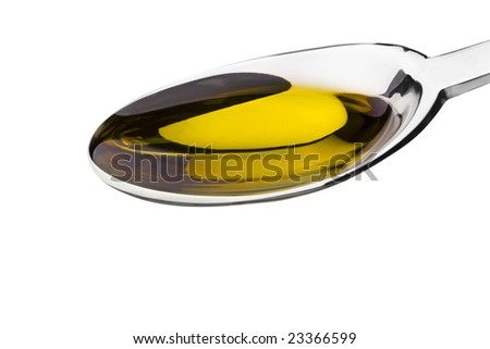 Spoon filled with olive oil isolated on white with clipping path