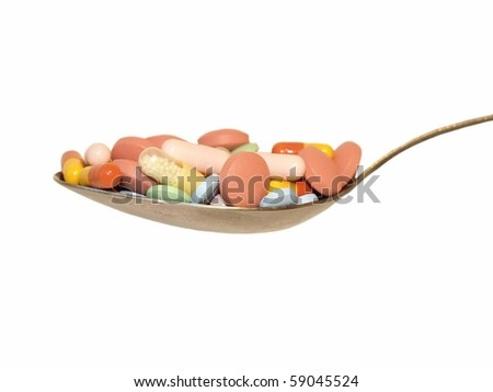 spoon full drugs, capsules, pills, medicine, isolated on white background - stock photo