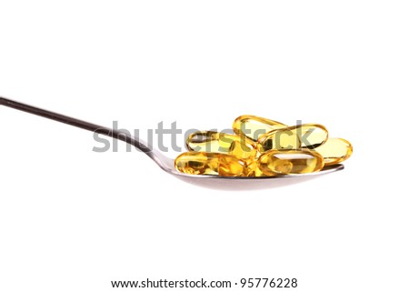 spoon full of fish oil capsules