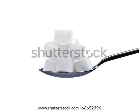 spoon full of white refined sugar cubes or lumps isolated on a white background