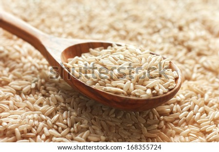 Spoon of brown rice close up