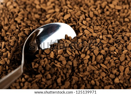 Spoon of coffee at coffe background - stock photo