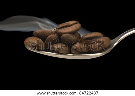 Spoon of coffee with smoke