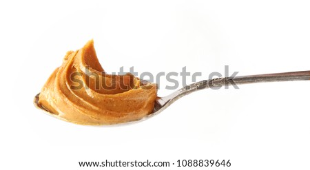 spoon of peanut butter isolated on white background #1088839646