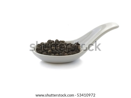 Spoon whit black pepper, isolated in the white background