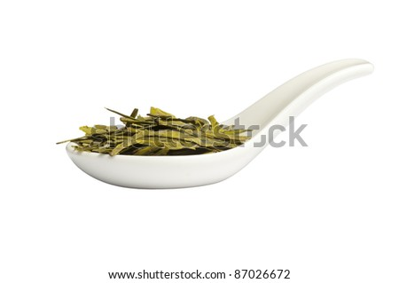 """Spoon with long leaves green loose  tea """"Dragon well"""",  isolated on white"""