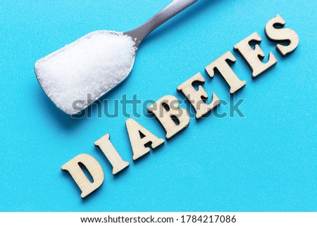 Spoon with sugar and inscription diabtes on a blue background, copy space Stock photo ©