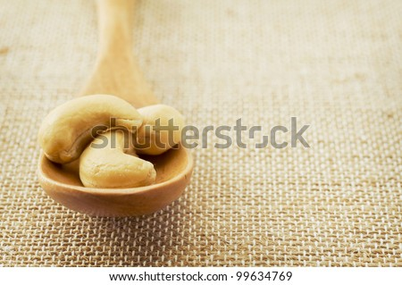 Spoonful of cashew nuts.