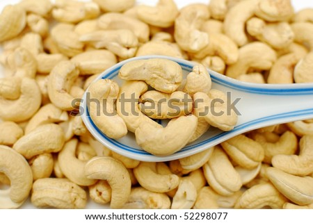Spoonful of cashew nuts. Signifying food and beverage, and healthy and nutritious eating.