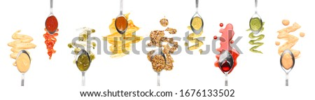 Spoons with different tasty sauces on white background, top view Сток-фото ©