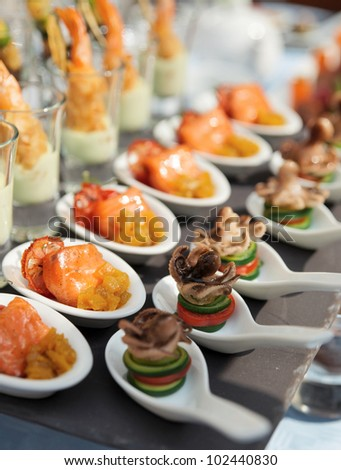 Spoons with seafood snacks -  banquet dish