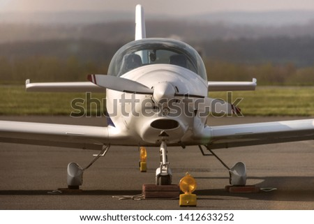 sport aircraft on the ground #1412633252