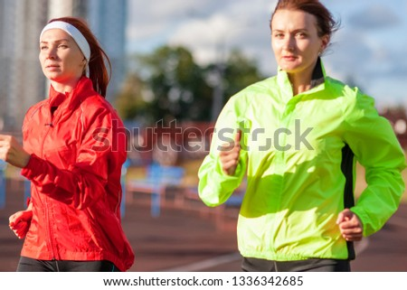 Sport and Athletics Concepts.Two Caucasian Females having Jogging Excercises Outdoors Together.Horizontal image