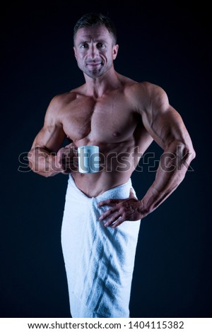 Sport and fitness. Body hygiene concept. Bodybuilder perfect naked body. Sexy sportsman wipe body towel after shower. Self care. Man muscular fit bare torso. Athlete with six pack and ab muscles.