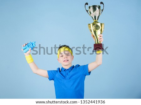 Sport and health. Gold prize. Gym workout of teen boy. success. Childhood activity. Fitness and diet. Energy. Happy child sportsman hold prize cup. prize winner. Feeling free and confident. #1352441936