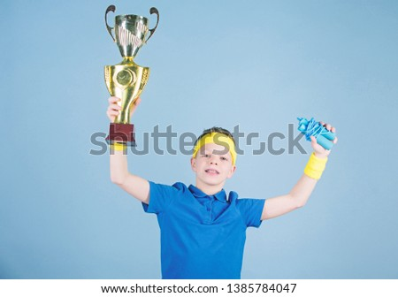 Sport and health. Gold prize. Gym workout of teen boy. success. Childhood activity. Fitness and diet. Energy. Happy child sportsman hold prize cup. prize winner. Feeling free and confident. #1385784047