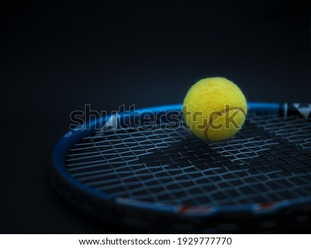 Sport and healthy lifestyle. Tennis. Yellow ball for tennis and a racket on table. Sports background with tennis concept, photo Сток-фото ©