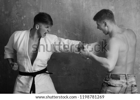 sport and recreation, workout and training, martial art and energy, healthy lifestyle, power and success, karate men twins #1198781269