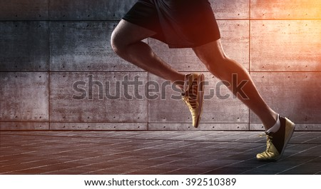 Sport background, close up of urban runner\'s legs run on the street with copy space