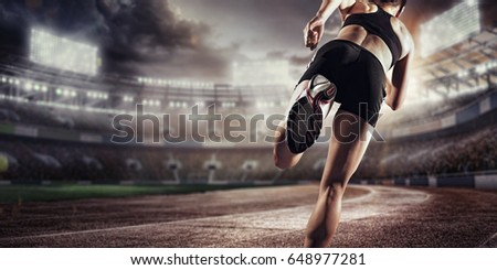 Sport background. Runner on the stadium. Dramatic scene. #648977281