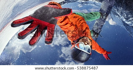 Sport background. Winter sport. Snowboarder jumping through air with deep blue sky in background. #538875487