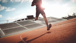 Sport Backgrounds, Male runner ready for sports exercise, Athlete running on athletic track.