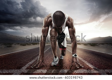 Sport backgrounds. Sprinter on the start line of the track befor the dramatic sky.