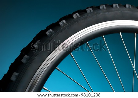 Sport bicycle tire and spoke wheel