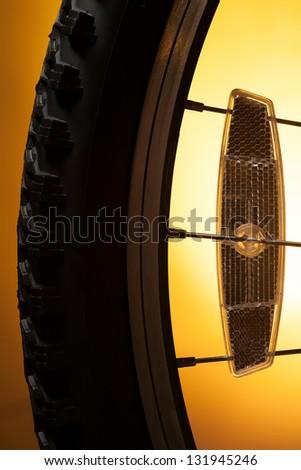 Sport bicycle tire on the orange - stock photo