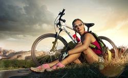 Sport bike woman on a rock