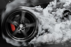 Sport car burns tires with drifting and smoking on track in preparation for the race.