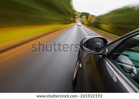 Sport car driving fast.