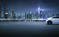 Sport car on roadside with night scene near the modern city background .
