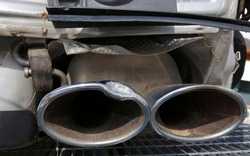 Sport car rear view, double exhaust pipe damage, stainless tail modern design
