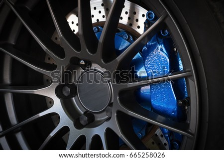 Sport car wheel and blue brake caliper #665258026