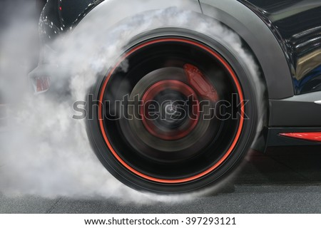 sport car wheel drifting and smoking on track dark edition
