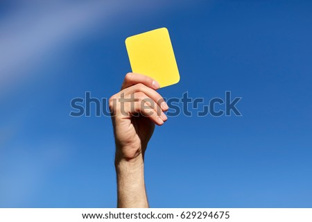 sport, caution, game and people - referee on football field showing yellow card #629294675